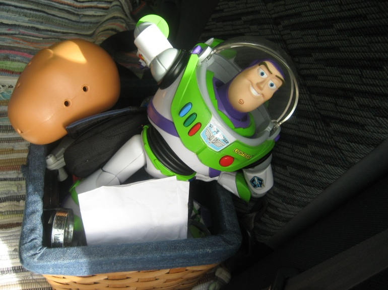 Buzz Lightyear and a bald Mr. Potatohead